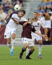 Real Salt Lake midfielder Jonny Steele (22) heads the ball over Colorado Rapids midfielder Brian Mullan (11) as Real Salt Lake's Chris Wingert (17) looks on during the first half of an MLS soccer game in Commerce City, Colo., Saturday, Aug., 4, 2012. (AP Photo/Jack Dempsey)