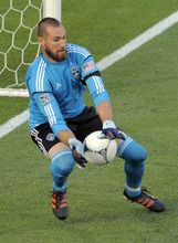 Colorado Rapids goalkeeper Matt Pickens blocks a shot against Real Salt Lake during the first half of an MLS soccer game in Commerce City, Colo., Saturday, Aug., 4, 2012. (AP Photo/Jack Dempsey)