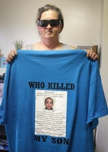 Rick Egan  | The Salt Lake Tribune   Shasta Hooper holds the shirt that she wears when she goes to West Wendover to find to who killed her son, Wednesday, August 1, 2012. It's been almost a year since Terron Hooper was run down outside of a West Wendover casino while celebrating his birthday with friends. His killer remains at large