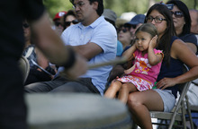Scott Sommerdorf  |  The Salt Lake Tribune              Three-year-old Miya Murakami holds her ears during a Taiko drumming performance at the ceremony prior to the groundbreaking for the Topaz Museum and Education Center in Delta to remember the nearby Topaz Relocation Camp, where Japanese-Americans were sent during World War II, Saturday, Aug. 4, 2012. Her grandfather, 85-year-old George Murakami, was an internee in the camp for more than three years during WWII.