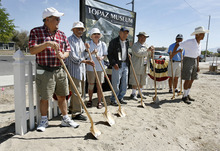 Scott Sommerdorf  |  The Salt Lake Tribune              Former internees at the Topaz Relocation Camp pose for a picture at the ceremonial groundbreaking for the Topaz Museum and Education Center in Delta, Saturday, Aug. 4, 2012. The museum is being built to remember the nearby Topaz Relocation Camp, where Japanese-Americans were sent during World War II. Willie Ito is at the far left, George Murakami is fourth from the left, and Toru Saito is at the far right.