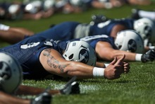 Chris Detrick  |  The Salt Lake Tribune Members of the football team work out during a preseason practice at the BYU outdoor practice field Thursday August 2, 2012.