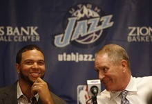 Trent Nelson  |  The Salt Lake Tribune  Utah Jazz point guard Deron Williams signed a multi-year contract extension with the team Friday, July 18, 2008. At right is team General Manager Kevin O'Connor.