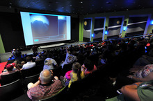 Hundreds watch the  images from Mars on the big screen as they watch NASA's Mars Curiosity rover land on Mars during a special viewing event at the U.S. Space and Rocket Center Monday, August 6, 2012 in Huntsville, Ala.  (AP Photo/The Huntsville Times, Eric Schultz)