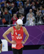 Jake Gibb of the United States reacts after a three set loss to Latvia during a mens quarterfinal beach volleyball match at the 2012 Summer Olympics, Monday, Aug. 6, 2012, in London. (AP Photo/Dave Martin)