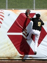 Kim Raff | The Salt Lake Tribune Salt Lake Bees player Trevor Crowe climbs the wall but misses a fly ball hit by the Oklahoma City Redhawks at Spring Mobile Ballpark in Salt Lake City, Utah on August 5, 2012.