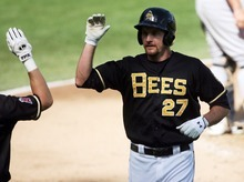 Kim Raff | The Salt Lake Tribune Salt Lake Bees player Ryan Langerhans comes home after hitting the second in back to back home runs against the Oklahoma City Redhawks at Spring Mobile Ballpark in Salt Lake City, Utah on August 5, 2012.
