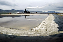 A raw materials storage pond lies in front of the USMagnesium production facility Tuesday, April 22, 2003 in Tooele, Utah. Magnesium is brewed from mineral-rich water baked for years in solar ponds. The smelter on the remote Great Salt Lake western shore ranked No. 1 on a government list of industrial air polluters for five years, a branding its executives disputed but found hard to counter. The company lost a pollution-rule appeal on Monday. (AP file Photo/Steve C. Wilson)