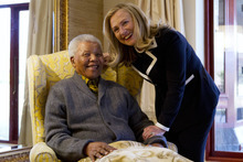 Jacquelyn Martin  |  The Associated Press Secretary of State Hillary Rodham Clinton meets Monday with former South Africa President Nelson Mandela, 94, at his home in Qunu, South Africa.