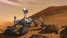 FILE - In this 2011 artist's rendering provided by NASA/JPL-Caltech, the Mars Science Laboratory Curiosity rover examines a rock on Mars. After traveling 8 1/2 months and 352 million miles, Curiosity landed on Mars Sunday night.   (AP Photo/NASA/JPL-Caltech, file)