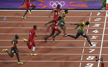 Jamaica's Usain Bolt crosses the finish line to win gold in the men's 100-meter final during the athletics in the Olympic Stadium at the 2012 Summer Olympics, London, Sunday, Aug. 5, 2012. (AP Photo/Christophe Ena)