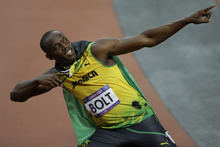 Jamaica's Usain Bolt reacts after winning the men's 100-meter during the athletics in the Olympic Stadium at the 2012 Summer Olympics, London, Sunday, Aug. 5, 2012. (AP Photo/Matt Slocum)