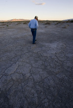 File  |  The Salt Lake Tribune Rancher Dean Baker walks through what was once a lush meadow in search of fresh water snail shells in the Snake Valley in this 2008 photo.