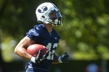 Chris Detrick     The Salt Lake Tribune BYU's Michael Alisa runs the ball during a preseason practice at the BYU outdoor practice field Thursday August 2, 2012.