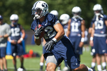 Chris Detrick  |  The Salt Lake Tribune BYU's Michael Alisa runs the ball during a preseason practice at the BYU outdoor practice field Thursday August 2, 2012.
