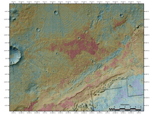 This image of a false-color map based on data from NASA's Mars Odyssey orbiter, and released by NASA/JPL-Caltech/ASU, shows the area where NASA's Curiosity rover landed on Sunday, Aug. 5, 2012. The image was obtained by Odyssey's Thermal Emission Imaging System. It merges topographical data with thermal inertia data that record the ability of the surface to hold onto heat. The yellow oval shows the elliptical landing target for Curiosity's landing site. An alluvial fan is visible around a crater to the northwest of the landing area. A series of undulating lines traveling southeast from the crater indicates similar material moving down a slope. The material, which appears bluish-green in this image, also forms a fan shape. An area in red indicates a surface material that is more tightly cemented together than rocks around it and likely has a high concentration of minerals. An attractive interpretation for this texture is that water could have been present there some time in the past. (AP Photo/NASA/JPL-Caltech/ASU)