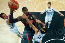 Lebron James (6) of the United States goes to the hoop against Luis Scola (4) of Argentina during their men's preliminary round basketball match at the 2012 Summer Olympics on Monday, Aug. 6, 2012, in London. (AP Photo/Christian Petersen, Pool)