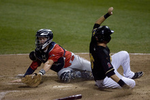 Kim Raff | The Salt Lake Tribune Salt Lake Bees player Matt Long beats the tag by Oklahoma City Redhawks catcher Chris Wallace to tie the game at 3-3 during the bottom of the 7th inning during a game at Spring Mobile Ballpark in Salt Lake City, Utah on August 6, 2012.