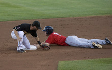 Kim Raff | The Salt Lake Tribune Salt Lake Bees Matt Long is too late with the tag on Oklahoma City Redhawks player Brian Bixler as he steals second during a game at Spring Mobile Ballpark in Salt Lake City, Utah on August 6, 2012.