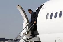 Republican presidential candidate, former Massachusetts Gov. Mitt Romney steps off his charter plane in Chicago before campaigning at Acme Industries in Elk Grove Village, Ill.,Tuesday, Aug. 7, 2012. (AP Photo/Charles Dharapak)