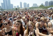Fans gather for a performance by Yellow Ostrich XX at Lollapalooza in Chicago's Grant Park on Friday, Aug. 3, 2012. (Photo by Sitthixay Ditthavong/Invision/AP)