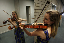 Francisco Kjolseth     The Salt Lake Tribune Violinist Kathryn Eberle, who is starting her second year as associate concertmaster of the Utah Symphony, often times uses a mirror to check her form as she practices. o