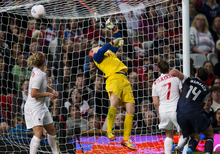 The game-winning goal sails over Canada goalkeeper Erin McLeod, center, as defenders Carmelina Moscato, left, and Rhian Wilkinson (7) and USA forward Abby Wambach (14) watch during extra time of the women's semifinal soccer match at the 2012 Summer Olympics, Monday, Aug. 6, 2012, in London. USA won 4-3. (AP Photo/The Canadian Press, Frank Gunn)