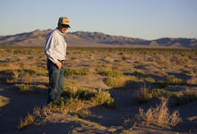 File  |  The Salt Lake Tribune  Rancher Dean Baker looks over what was once a lush meadow in the Snake Valley in this 2008 photo. While the Bureau of Land Management excluded the valley on the Utah-Nevada line from its recently released final Environmental Impact Statement, the battle over groundwater is likely to continue.