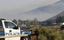 Al Hartmann  |  The Salt Lake Tribune   Eagle Mountain police guard the North Ranch neighborhood while it was still under evacuation Tuesday morning Aug. 8 as the Pinyon Fire continued to burn in the mountains on Camp Williams land to the north. The evacuation order was lifted shortly afterward.