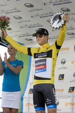 Christian Vandevelde of  the Garmin-Sharp team  wears the yellow jersey after his team won the team time trial Wednesday.