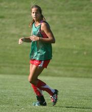 Steve Griffin | The Salt Lake Tribune   East high's Eliza Hard chases the ball during soccer practice at the Salt Lake City, Utah school Friday August 3, 2012.
