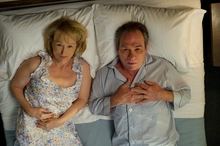 This film image released by Columbia Pictures shows Meryl Streep as Kay Soames, left, and Tommy Lee Jones as Arnold Soames in a scene from