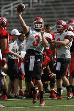 Francisco Kjolseth  |  The Salt Lake Tribune Jordan Wynn looks for an opening as the Utah football team practices on Wednesday, August 8, 2012.