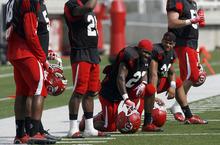 University of Utah football team practices on the football field on Wednesday, August 8, 2012.