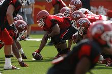 Francisco Kjolseth  |  The Salt Lake Tribune The Utah football team practices on the football field on Wednesday, August 8, 2012.
