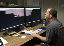 Michael Malin, principal investigator, Mars Descent Imager on MSL, Malin Space Science Systems looks at a data set of the the first 360-degree panorama in color of the Gale Crater landing site taken by NASA's Curiosity rover, as it is processed at NASA's Jet Propulsion Laboratory in Pasadena, Calif., early morning Thursday, Aug. 9, 2012. The images were taken late Aug. 8 PDT (Aug. 9 EDT) by the 34-millimeter Mast Camera. This panorama mosaic was made of 130 images of 144 by 144 pixels each. Selected full frames from this panorama, which are 1,200 by 1,200 pixels each, are expected to be transmitted to Earth later. The images in this panorama were brightened in the processing. Mars only receives half the sunlight Earth does and this image was taken in the late Martian afternoon. (AP Photo/Damian Dovarganes)