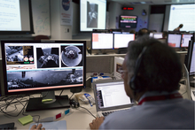 Maher Hanna, Manager, Instrument and Science Data System Operations Group at Jet Propulsion Laboratory works on incoming image data sets from NASA's Curiosity rover and Mars Reconnaissance Orbiter as they continuing to develop Curiosity's landing on Mars at the Surface Mission Support Area, SMSA control room at NASA's JPL in Pasadena, Calif., Thursday, Aug. 9, 2012. The images are taken by Curiosity's just activated navigation cameras, or Navcams. (AP Photo/Damian Dovarganes)