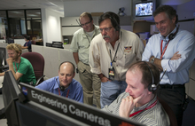 NASA's engineers look at image sets from NASA's Curiosity rover and Mars Reconnaissance Orbiter as they  continuing to develop the story of Curiosity's landing on Mars at the Surface Mission Support Area, SMSA NASA's JPL in Pasadena, Calif., Thursday, August 9, 2012. The images from Curiosity's just-activated navigation cameras, or Navcams. From left: Brandon Metz, Jordan Evans, David Muliere, Justin Maki and Michael Watkins. (AP Photo/Damian Dovarganes)
