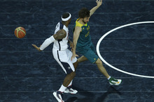 Victor R. Caivano | The Associated Press Lebron James, left, passes the ball behind his back in front of Australia's Matt Nielsen. James finished with a triple-double: 11 points, 11 assists and 14 rebounds.