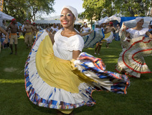 Paul Fraughton   The Salt Lake Tribune Dancers  from Colombia's Grupo de Danzas Folklóricas Carmen López twirl and dance their way in the