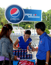 In a photo provided by PepsiCo Inc., PepsiCo's drinks are on display outside the Capital Hypermarket in Yangon, Myanmar, Thursday, Aug. 9, 2012. The company said Thursday that it struck a deal to distribute three of its drinks in the country. The U.S. government decided earlier this year to suspend investment sanctions on the country, following its democratic reforms. (AP Photo/ PepsiCo Inc.)