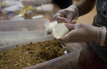 Kim Raff | The Salt Lake Tribune Ana Valdemoros, whose company is Argentina's Best Empanadas, wraps beef empanadas in the kitchen of Martin's Fine Desserts in Salt Lake City, Utah on August 3, 2012.