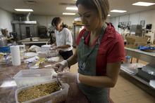 Kim Raff | The Salt Lake Tribune Ana Valdemoros, whose company is Argentina's Best Empanadas, wraps beef empanadas in the kitchen of Martin's Fine Desserts in Salt Lake City on August 3, 2012.