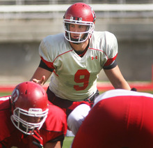 Steve Griffin | The Salt Lake Tribune   Utah quarterback Jon Hayes sets the offense during scrimmage August 9, 2012.