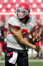 Steve Griffin | The Salt Lake Tribune   Utah quarterback Travis Wilson follows through on a pass during a scrimmage Aug. 9, 2012.