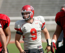 Steve Griffin | The Salt Lake Tribune   Utah quarterback Jon Hayes runs up field during a scrimmage Aug. 9, 2012.