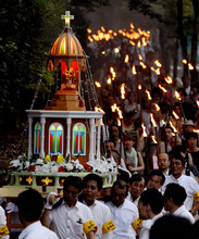 A Maria statue damaged during the atomic bombing of Nagasaki is carried to lead a torch procession in Nagasaki, southern Japan, Thursday, Aug. 9, 2012, marking the 67th anniversary of the world's second atomic bomb attack. (AP Photo/Kyodo News)