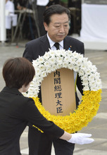 Japan's Prime Minister Yoshihiko Noda offers a wreath during a ceremony held in front of the Statue of Peace at Nagasaki Peace Park in Nagasaki, southern Japan Thursday, Aug. 9, 2012 to mark the 67th anniversary of the world's second atomic bomb attack. (AP Photo/Kyodo News)