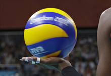 USA's Destinee Hooker (19) spins the ball before serving to South Korea during a women's volleyball semifinal match at the 2012 Summer Olympics Thursday, Aug. 9, 2012, in London. (AP Photo/Chris O'Meara)