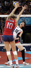 South Korea's Kim Yeon-koung (10) goes up for a spike over USA's Jordan Larson (10, left) during a women's volleyball semifinal match at the 2012 Summer Olympics Thursday, Aug. 9, 2012, in London. (AP Photo/Chris O'Meara)